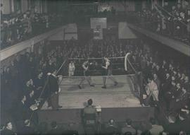 Photograph of a boxing match in the gymnasium at Regent Street