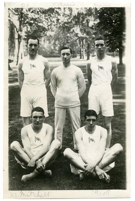 Photograph of four boxers and their trainer